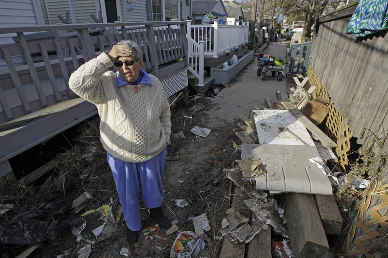 Ginny Flanagan, 70, returns to her damaged home and destroyed neighborhood in Breezy Point on Sunday for the first time in the wake of Superstorm Sandy.