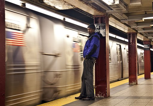A commuter waits as the first A train approaches the platform at Penn Station in New York City as MTA resumed limited service on Thursday.