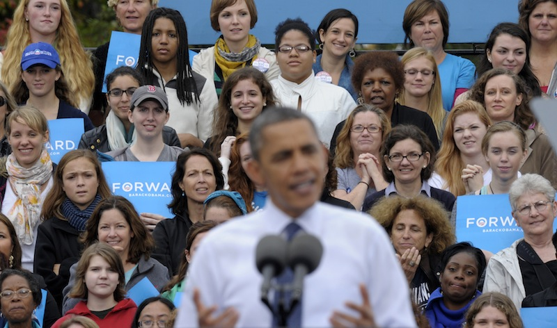 This Oct. 19, 2012 file photo shows thee audience, who were mostly women, listen behind President Barack Obama as he speaks about the choice facing women in the election during a campaign event at George Mason University in Fairfax, Va. Sorry, fellas, but President Barack Obama's re-election makes it official: Women can overrule men at the ballot box. For the first time in research dating to 1952, the candidate whom the most men chose – Mitt Romney – lost. More women voted for the other guy. It's surprising it didn't happen sooner, since women have been voting in larger numbers than men for almost three decades, exit polls show. (AP Photo/Susan Walsh, File)