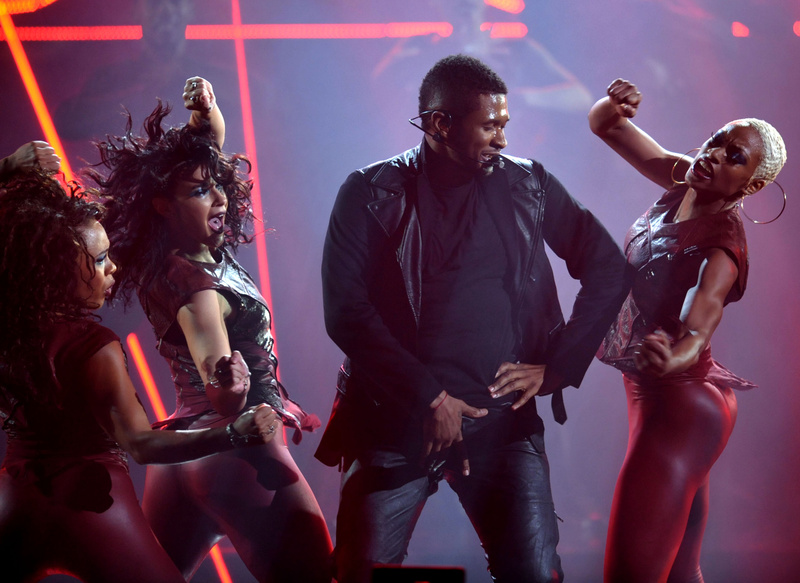 Usher performs at the American Music Awards on Sunday.