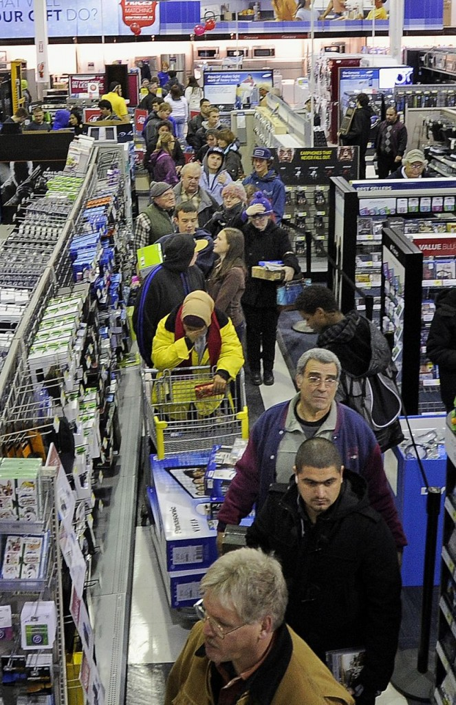 Black Friday shoppers wait in line just after midnight at the Best Buy in the Maine Mall in South Portland on Friday.