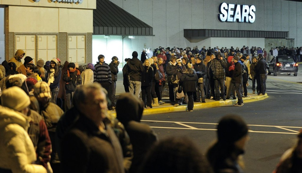 Black Friday shoppers waited in line before midnight to get into Best Buy at the Maine Mall in South Portland.