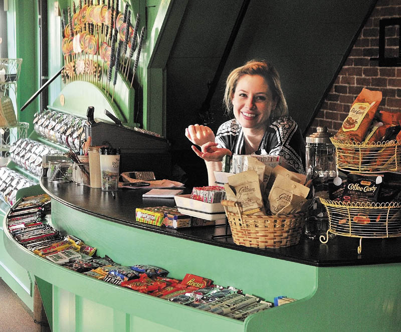 Hilary Davis behind the counter in the Scrummy Afters Novelty Candy Shoppe on Water Street in Hallowell.