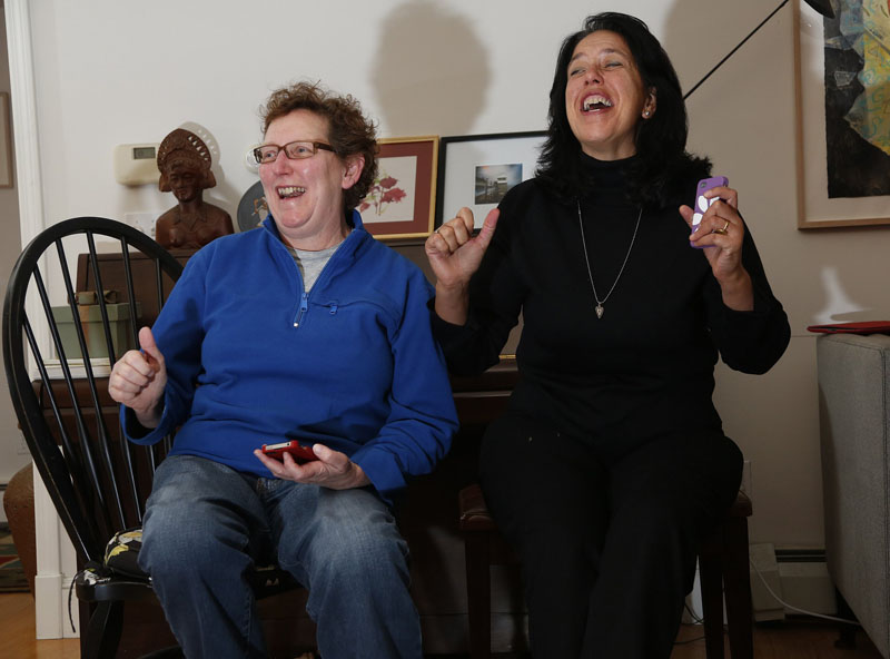 Norine Kotts, left, and Cheryl Lewis of Scarborough celebrate as presidential race results come in, Tuesday, Nov. 6, 2012, during a party at their house.