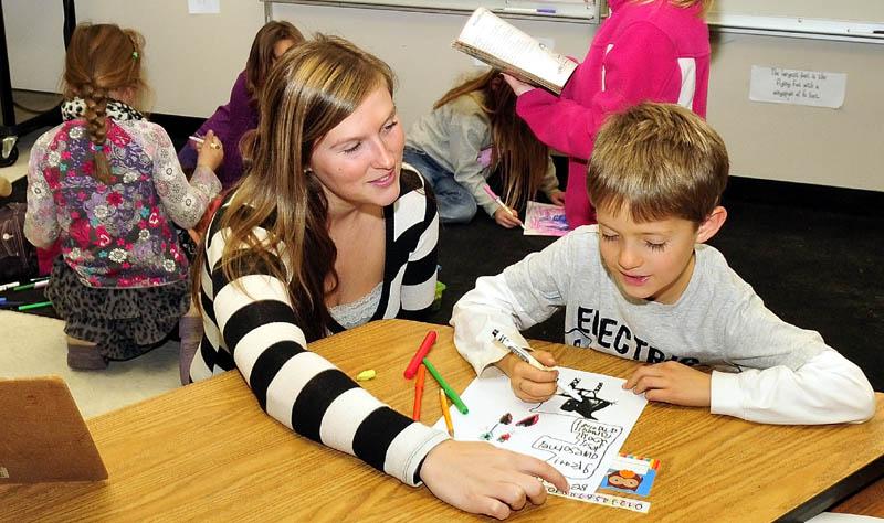 Cornville Regional Charter School teacher Danielle Beaman helps student Barret Walker recently.