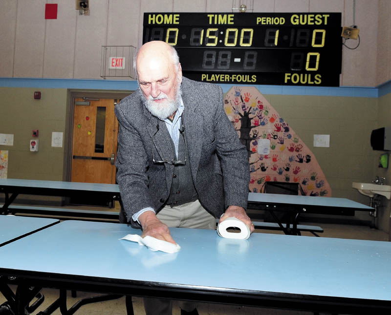 Cornville Regional Charter School Principal Bill Crumley pitched in and helped clean cafeteria tables recently.