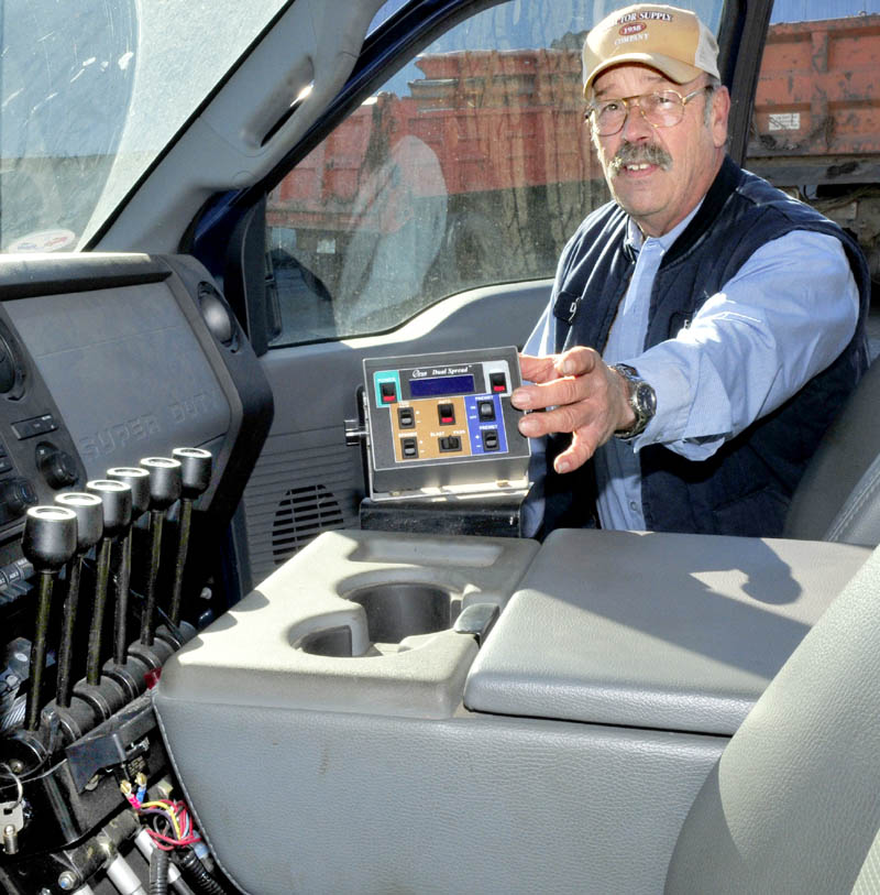 Farmington Director of Public Works Denis Castonguay shows a small computer inside one of the town plow trucks. The equipment can be programed for the most efficient use of salt on winter roads, in terms of both economic and environmental impact.