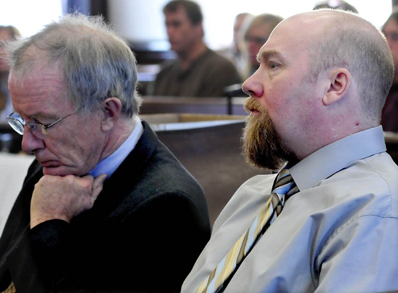 Murder defendant Robert Nelson, right, listens to opening statements in his trial in the death of Everett Cameron, on Monday in Somerset Superior Court in Skowhegan. At left is defense attorney John Alsop.