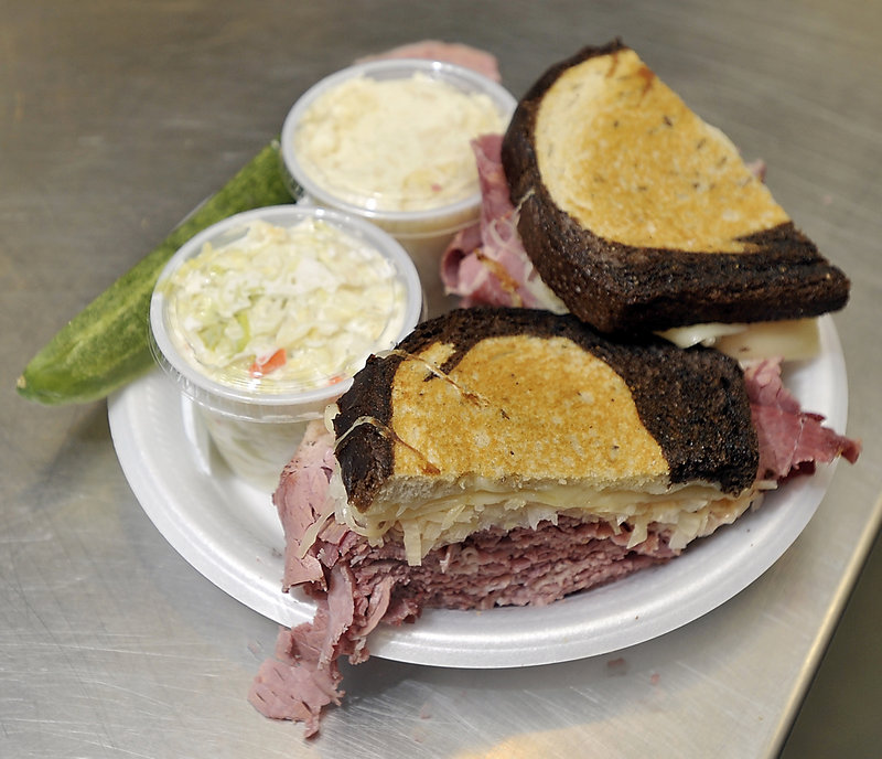 Order the corned beef Reuben special from Full Belly Deli on Brighton Avenue in Portland, and the hefty sandwich arrives accompanied by some sidekicks – a pickle, coleslaw and potato salad.