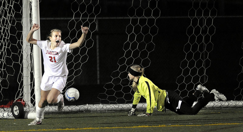 Katherine Kirk celebrates the only goal in Wednesday's match, scored by Sarah Martens in the 65th minute of the Western Class A girls' soccer final. The ball was just out of reach of the Capers' keeper Mary Perkins.