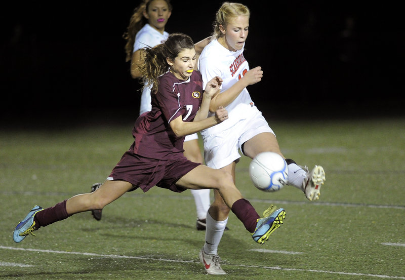Kathryn Cook of Cape Elizabeth, left, tries to edge out Maria Philbrick of Scarborough for possession in the second half Wednesday.