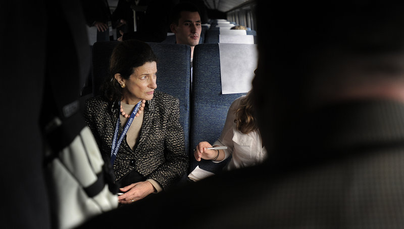 Sen. Olympia Snowe, shown aboard the Amtrak Downeaster's inaugural ride to Freeport and Brunswick, urges bipartisanship as she retires from public office.