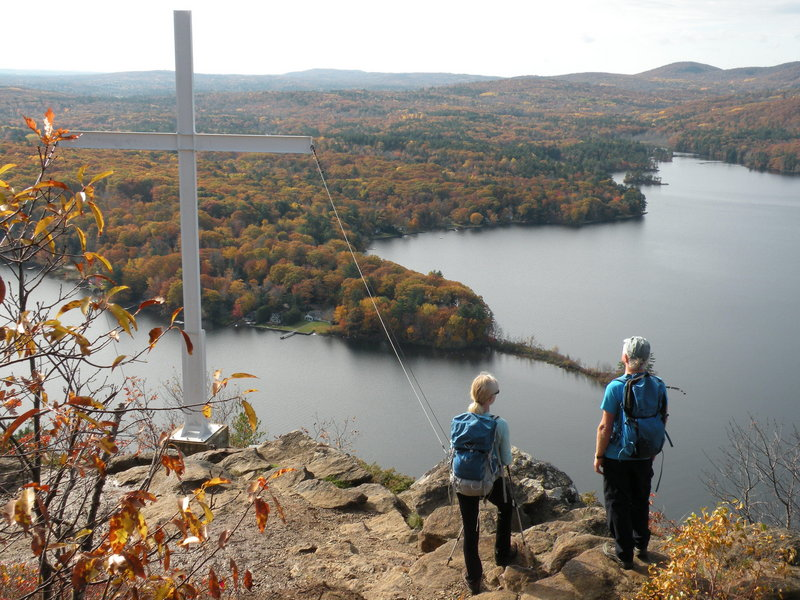 Maiden Cliff overlooks Megunticook Lake and includes a granite marker dedicated to Elenora French, who feel to her death near this spot in 1864 while chasing her hat.