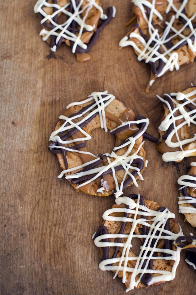 These apple chips are coated with caramel, white chocolate and dark chocolate.