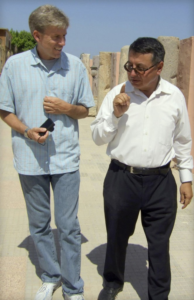 Christopher Stevens, U.S. ambassador to Libya, walks with a translator during a tour of Libya's national museum in Tripoli. Letters critical of President Obama and the State Department for failing to prevent an attack in which Stevens was killed don't take into account the risks of civil service in the volatile region, a reader says.