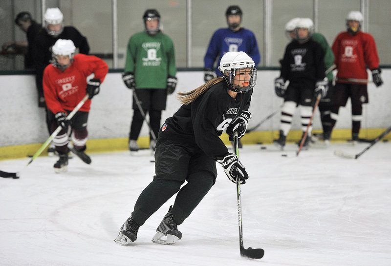 Chelsey Andrews, a Greely senior defenseman, carries the puck during a stick-handling drill Monday – the opening day for high school girls' hockey practice in Maine. Greely enters the season as the reigning state champion and is expected to be a top contender again.
