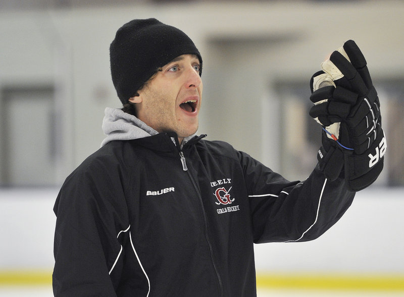 Nate Guerin shouts instructions to his players during the opening day of practice at Family Ice Center. Guerin guided Greely to a state championship in his second season as head coach.