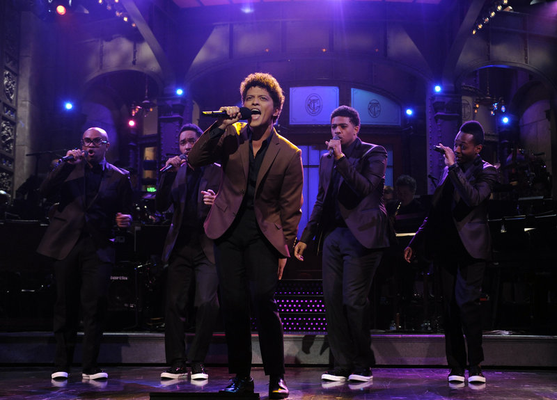 "Bruno Mars performs as guest host on ""Saturday Night Live"" on Oct. 20. He pledged that in the future, ""Whatever they need from me, they can get."""