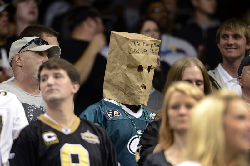 """A disgruntled Philadelphia Eagles fan wears a bag that says, """"This pretty much says it all"""" at last week's game against New Orleans at New Orleans. The Saints beat the Eagles 28-13, and Philadelphia fell to 3-5 on the year."""