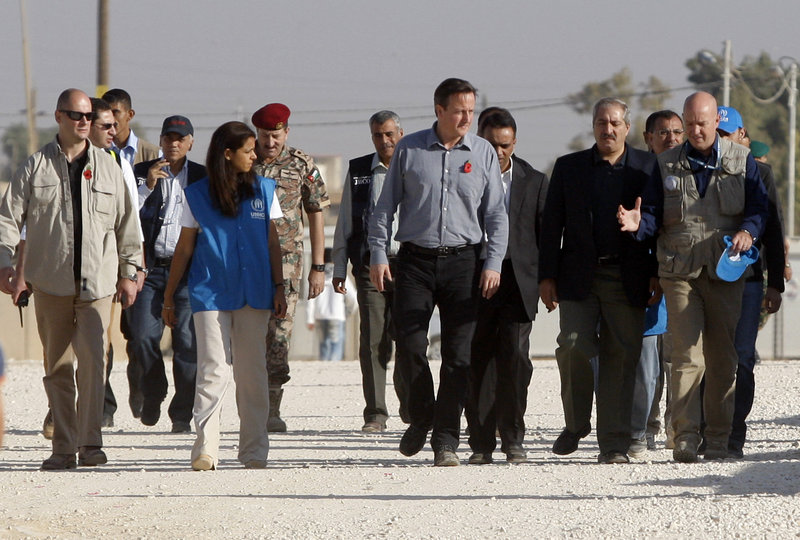 British Prime Minister David Cameron, center, and U.N. officials visit a camp for Syrian refugees in Jordan. Cameron urged allies to work directly with rebel military commanders.