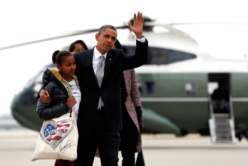 President Barack Obama and daughter Sasha prepare to board Air Force One Wednesday for the trip back to Washington from Chicago.