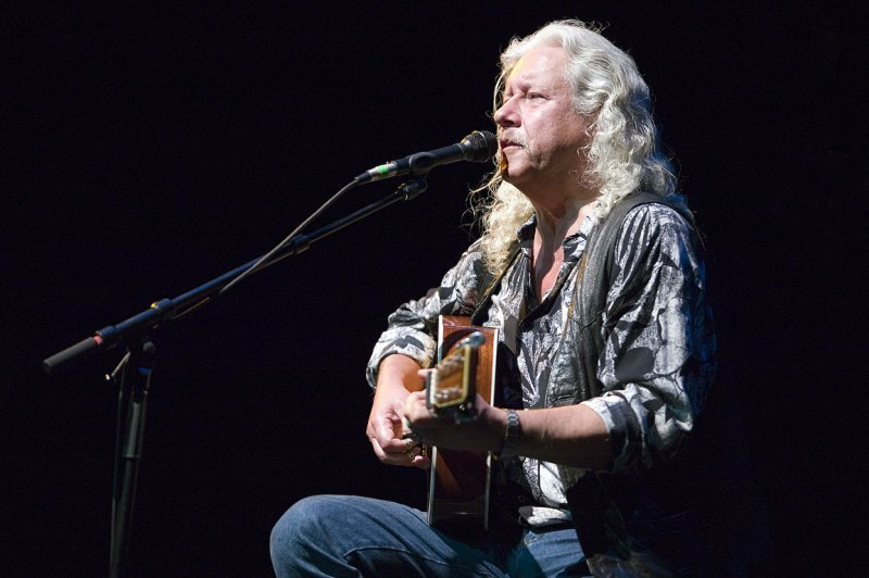 """Arlo Guthrie performs in a celebration of his father's music, """"Here Comes the Kid: Celebrating Woody Guthrie's 100th Birthday,"""" on Wednesday at the Strand Theatre in Rockland."""