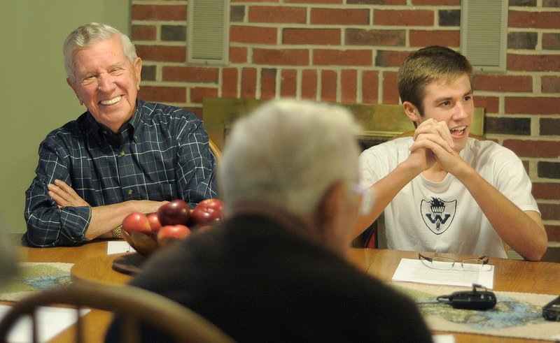 """Bill Currier, left, shares a laugh with Westbrook High School junior Morgan Rielly, right, at Rielly's house last Monday. Rielly interviewed Currier, along with other veterans, for a book he wrote titled """"Neighborhood Heroes: Life Lessons Learned from Maine's Greatest Generation."""""""
