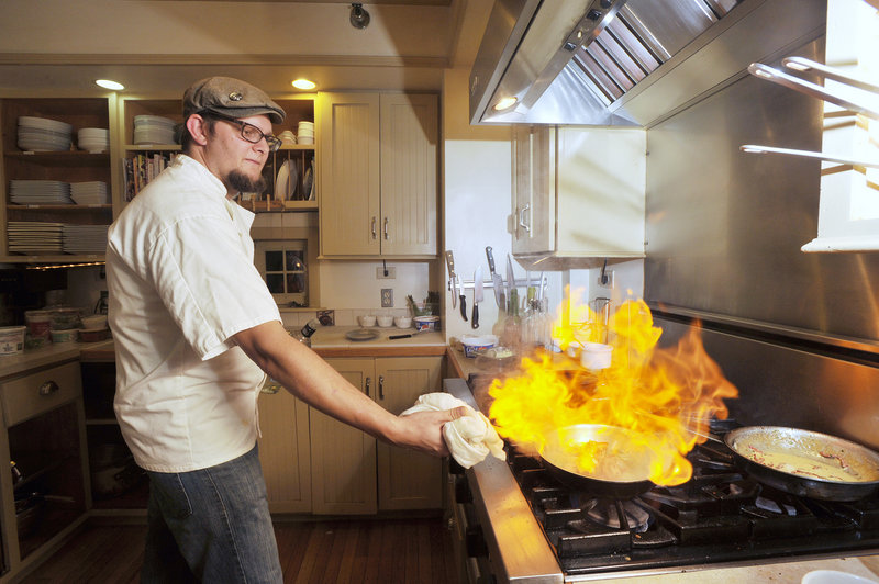 In the kitchen at 91 South in Gorham, chef Noah Gaston applies the flame to a Greek cheese appetizer called saganaki.