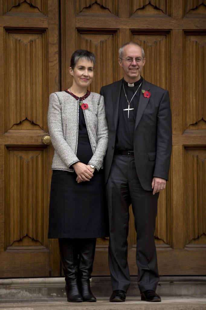 Britain's bishop of Durham Justin Welby poses with his wife, Caroline, in London Friday after he was named the next archbishop of Canterbury. He will succeed Rowan Williams in leading the world's 77 million Anglicans.