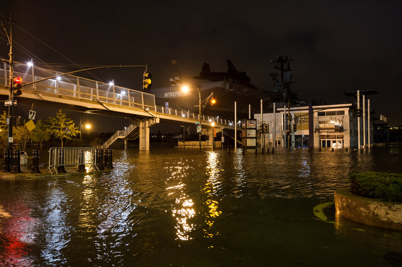 """Superstorm Sandy floods Manhattan's West Side Highway on Oct. 29. Both Sandy and last summer's """"extraordinary weather events"""" should jump-start a national discussion on preventing climate change, a reader says."""