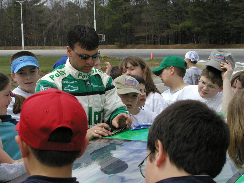 """Jason Fowler signs autographs for young fans in this photo taken about 10 years ago. Fowler """"always would put a smile on someone's face,"""" a friend wrote on his Facebook page."""