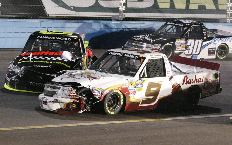 Johnny Sauter, left, collides with Ron Hornaday Jr., center, as Nelson Piquet Jr., slides past unscathed on the 66th lap of the Camping World Truck Series race Friday at Avondale, Ariz. Brian Scott won the race, while James Buescher retained the points lead with one race left.