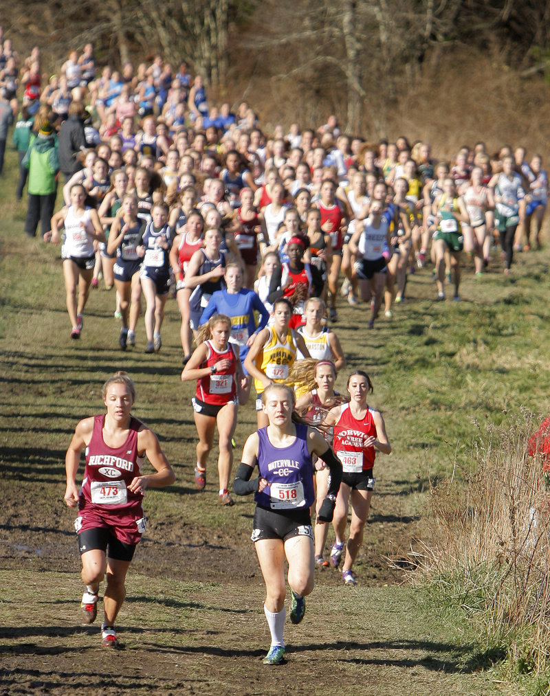 Bethanie Brown, right, of Waterville runs alongside eventual winner Elle Purrier of Richford, Vt., in the early stages of the girls' race. Brown was the top Maine girl, in seventh place.