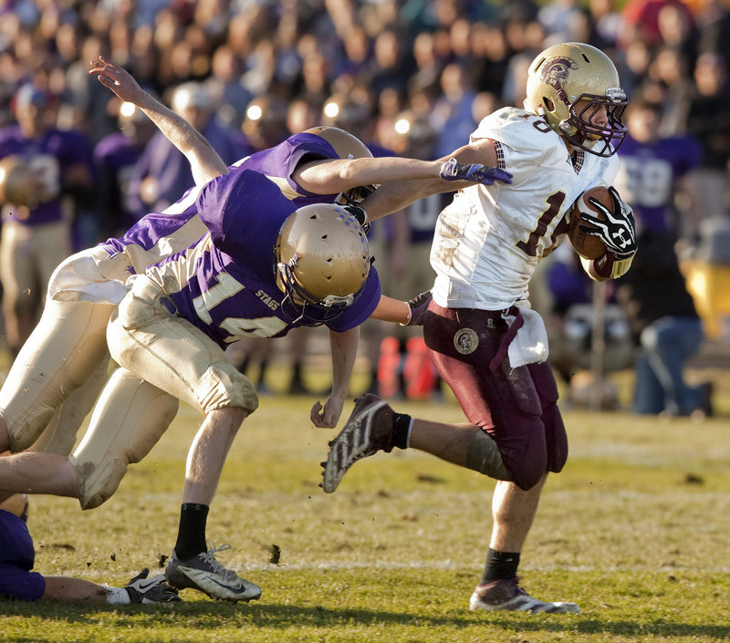 Andrew Libby of Thornton Academy was tough to stop all game, including this touchdown run in the fourth quarter Saturday. Libby scored all three touchdowns for the Trojans in a 20-13 victory against Cheverus.