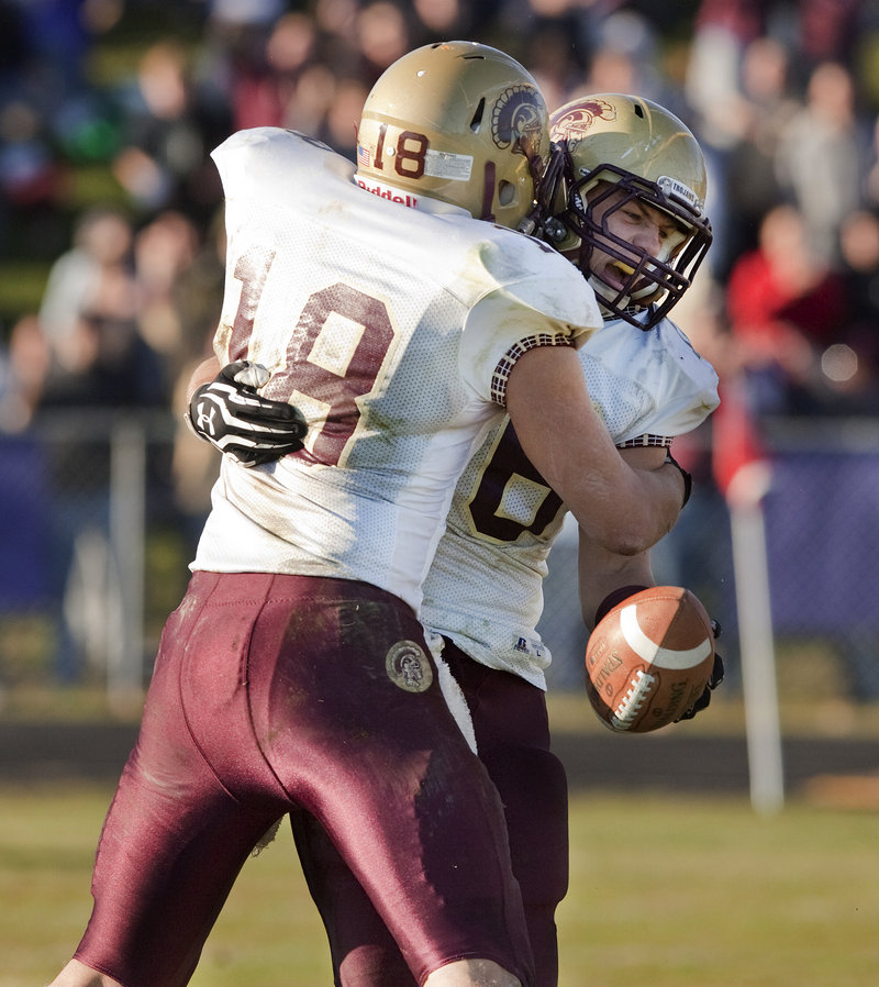 Cody Lynn, 18, hugs Andrew Libby after a Libby touchdown Saturday helped Thornton reach the Class A final.