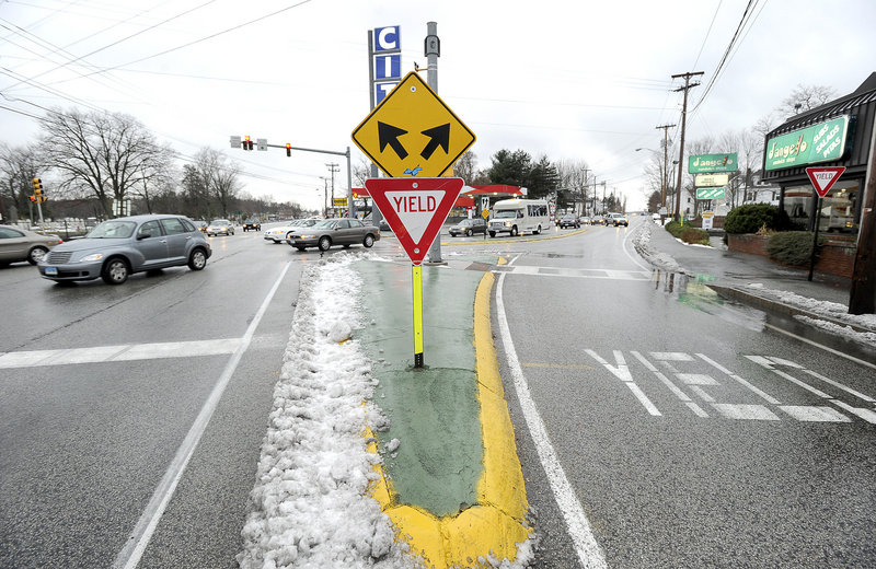 The Maine Department of Transportation wants to replace this yield sign with a signal light at the Five Points intersection in Biddeford to improve traffic flow and safety. A public meeting will be held this week.