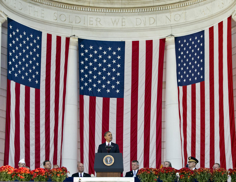 President Obama speaks during a Veterans Day ceremony at the Arlington National Cemetery Amphitheater.