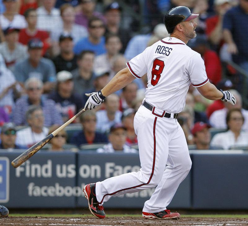 Catcher David Ross, 36, helped lead the Atlanta Braves to a National League wild card spot last season.