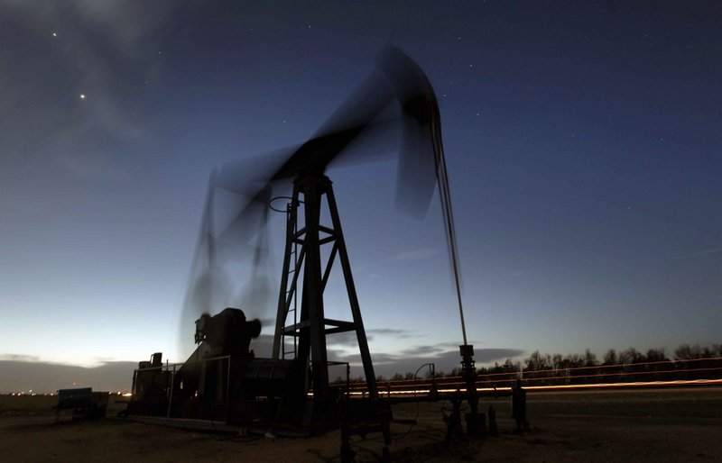 A pumping unit sucks oil from the ground near Greensburg, Kan. The United States will become the world's largest oil producer by around 2020, temporarily overtaking Saudi Arabia, the International Energy Agency forecast Monday.