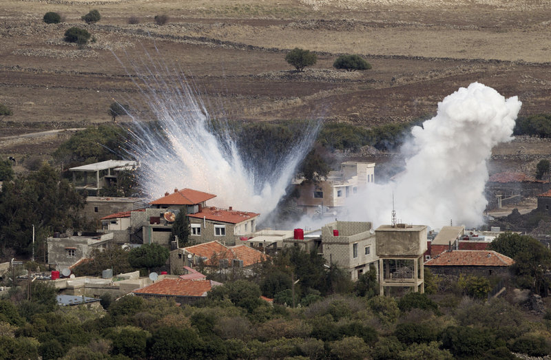 """Smoke rises after shells fired by the Syrian army explode in the Syrian village of Bariqa. Israel said """"Syrian mobile artillery"""" was hit after Israel responded to stray mortar fire."""
