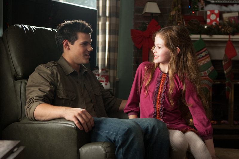 "Taylor Lautner and Makenzie Foy in ""The Twilight Saga: Breaking Dawn – Part 2."""