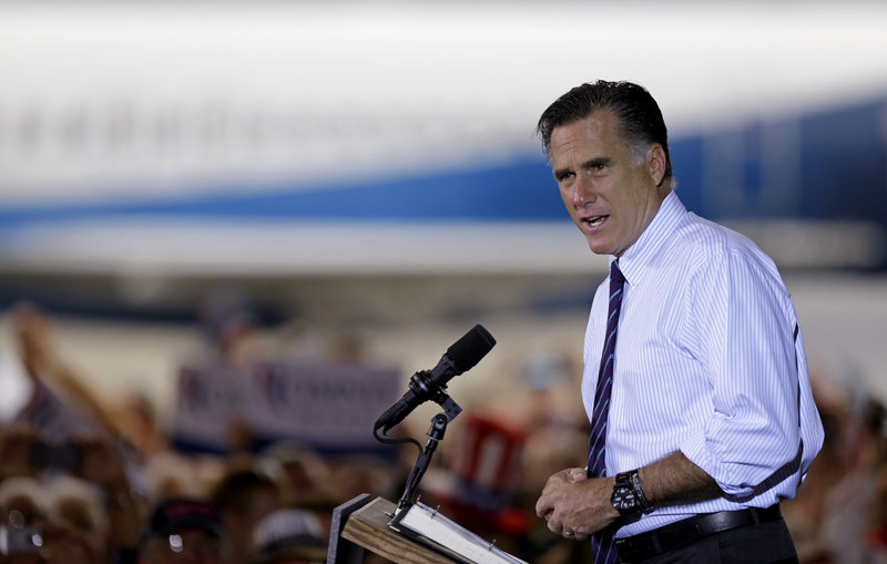 """Republican presidential candidate Mitt Romney speaks at a campaign event in Sanford, Fla., the day before the election. A reader calls on columnist M.D. Harmon to """"take a cue from Mitt Romney's concession speech urging our citizens to support the president and pray for him."""""""