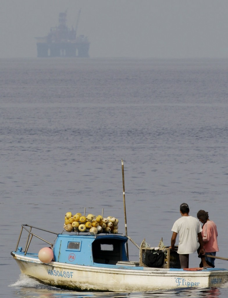 Last January, an oil rig starts exploratory drilling beneath the waters off Cuba's northern coast as fishermen work in Havana Bay. The exploratory oil well failed and will be capped.