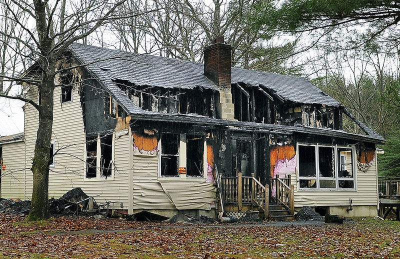 This house at 580 Dow Road in Orrington, scene of a multiple-fatal fire Saturday, stands charred from the inside out on Tuesday.