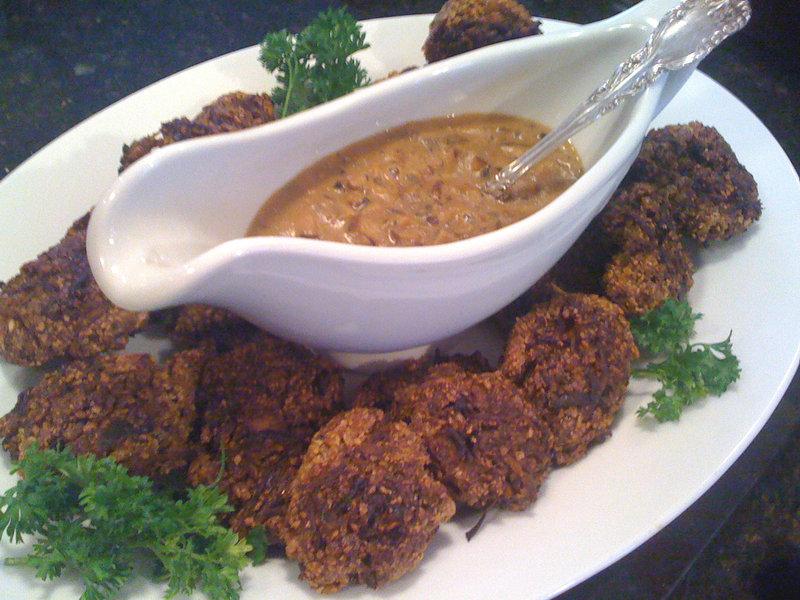 Pumpkin seed croquettes surround shiitake mushroom gravy.