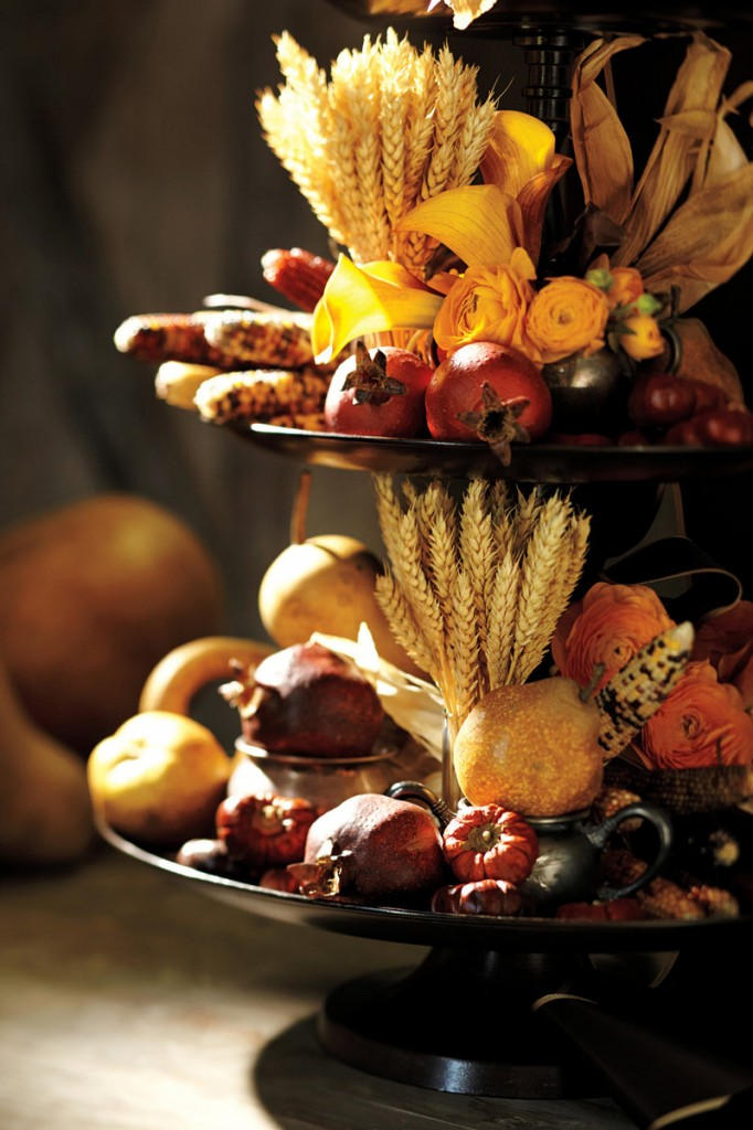 Realistic, long-lasting faux fruits and vegetables are great additions to a multi-tiered cornucopia arrangement.