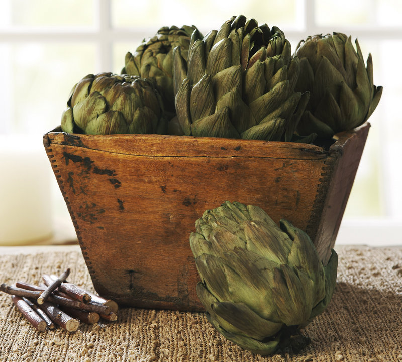 A collection of faux artichokes from Potterybarn.com offers a rustic alternative to a more traditional cornucopia look.