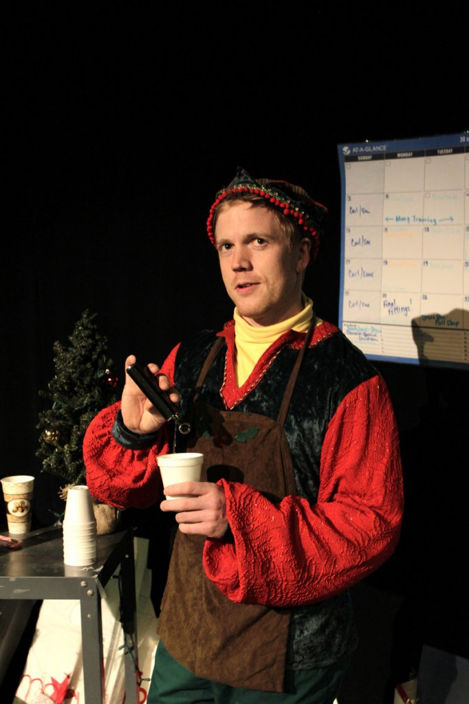 """Dustin Tucker as the cynical elf Crumpet in the Portland Stage production of """"The Santaland Diaries"""" by David Sedaris."""