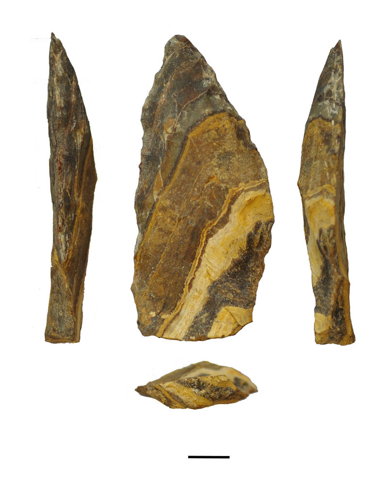 Different angles of an estimated 500,000-year-old stone point from South Africa's Northern Cape. The scale bar at bottom is 1 centimeter long.