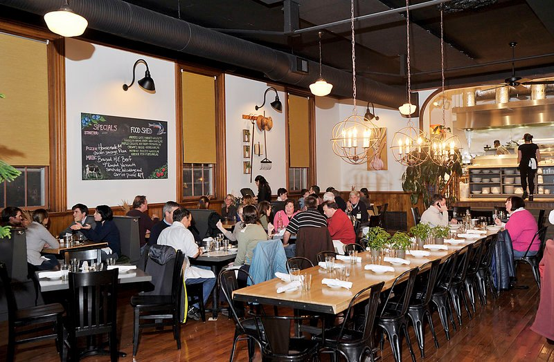 """Gather, a new restaurant in Yarmouth, is housed in a former 1860s Masonic hall. A communal table for 18 sits central in the space. """"It's a twist that mostly works,""""owner Matt Chappell said, as does the well-prepared food at reasonable prices."""